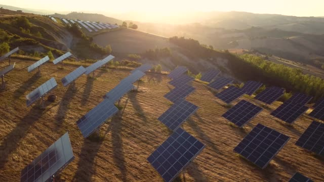 Green energy field on hills in Italy - Solar panels