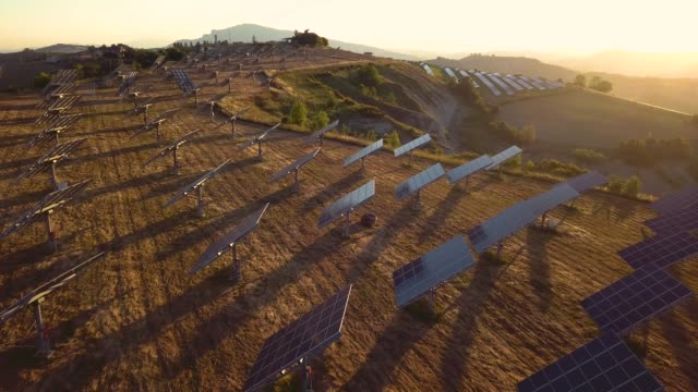 green energy field on hills in italy - solar panels - sustainable resources stock videos and b-roll footage