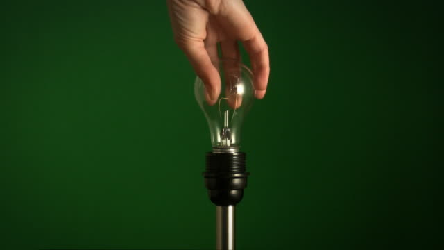 green energy fluorescent bulb. - incandescent bulb stock videos and b-roll footage