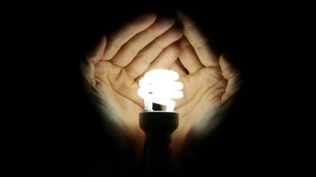 green energy lightbulb - energy efficient lightbulb stock videos and b-roll footage
