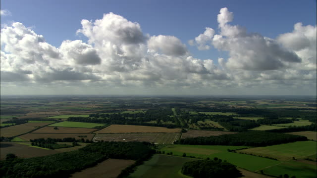 green english landscape under blue sky - aerial view - england, norfolk, king's lynn and west norfolk district, united kingdom - norfolk england stock videos & royalty-free footage
