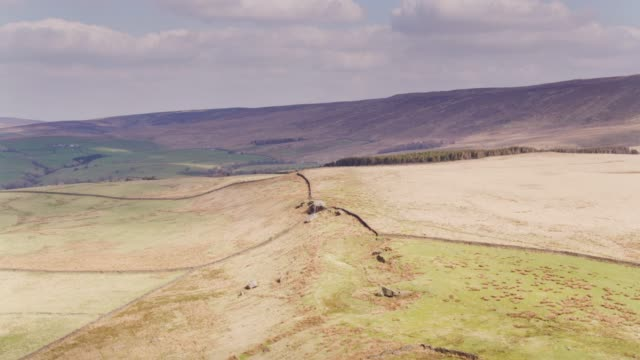 green fields and brown moorland in lancashire pennines - drone shot - pennines stock videos and b-roll footage