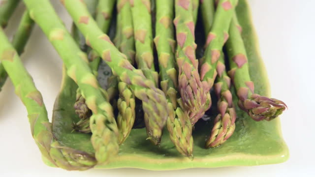 Green fresh and wet asparagus