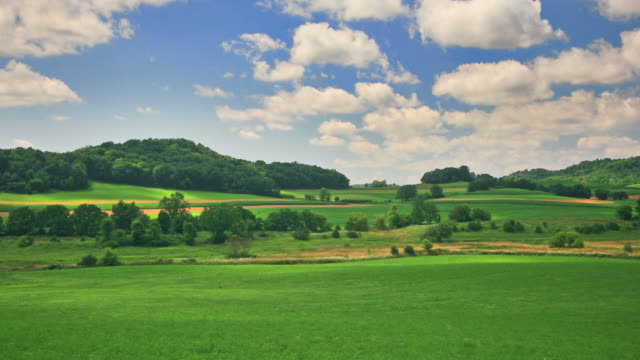 green hills and blue sky. hq 1080p. rgb 4:4:4 - pasture stock videos & royalty-free footage