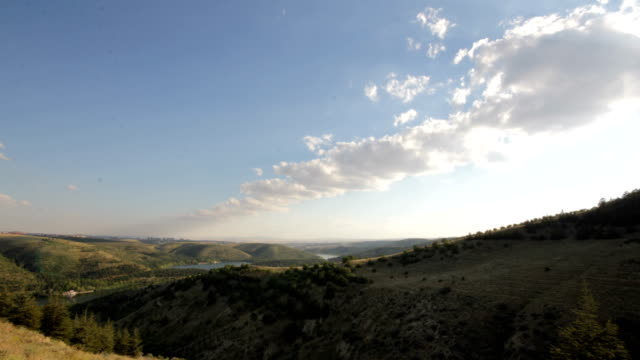 green hills with shadows from the clouds timelapse - steppe stock videos & royalty-free footage