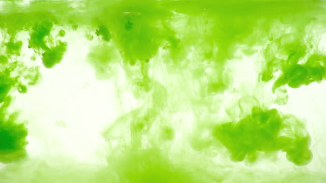 green ink dissolving in water - dissolving stock videos & royalty-free footage