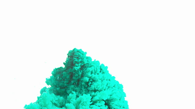 Green Ink entering Water against white Background, Slow motion 4K