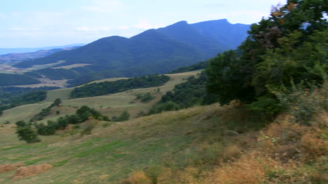 ws pan green land mountain / armenia  - eastern european culture stock videos & royalty-free footage