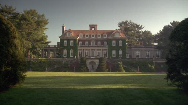 stockvideo's en b-roll-footage met green landscaping surrounds a huge estate in old westbury, new york. - landhuis