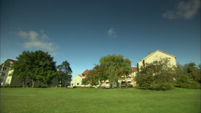 ws pan green lawns and apartment buildings / malmo, sweden - malmo stock videos and b-roll footage