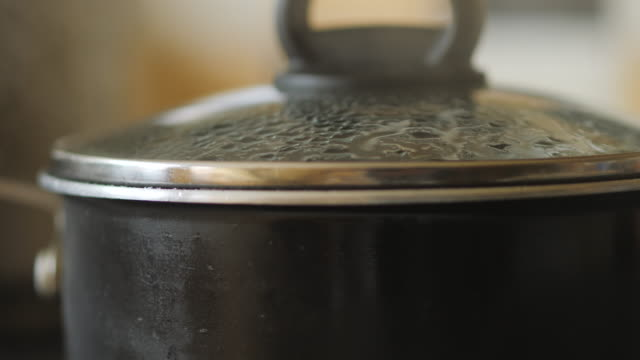 green lentils in boiling water for cooking - lid stock videos & royalty-free footage