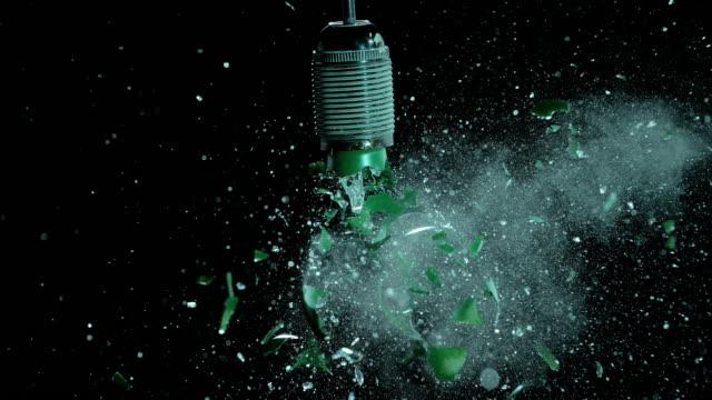 SLO MO green light bulb explosion