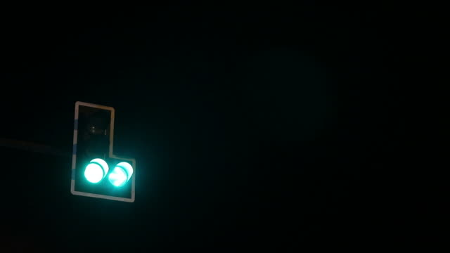 green light signal, red light in the dark. - traffic light stock videos & royalty-free footage