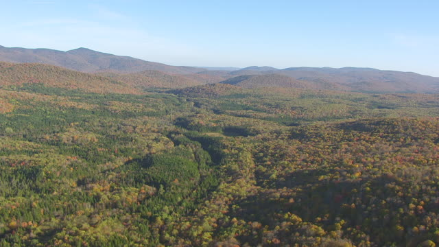 WS AERIAL POV Green Mountain National Forest area with mountains in background / Stratton, Windham County, Bennington County, Vermont, United States