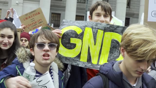green new deal logo. in light of the climate discussions by world leaders at the united nations cop 25 in madrid, spain, nyc school students rallied... - individual event stock videos & royalty-free footage