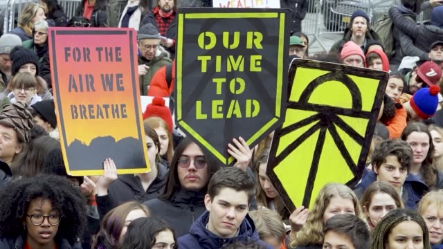 green new deal logo in light of the climate discussions by world leaders at the united nations cop 25 in madrid spain nyc school students rallied in... - new deal video stock e b–roll