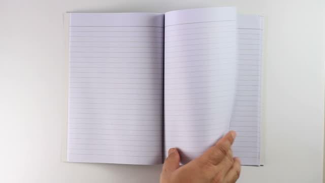 vídeos de stock e filmes b-roll de nota livro verde - caderno de notas
