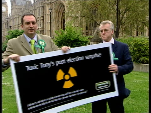 green party england london westminster ext ms daren johnston unveiling billboard poster with slogan 'toxic tony's postelection surprise' clean feed... - green party stock videos and b-roll footage