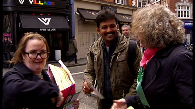 green party london mayor candidate on police extremist list t17041210 / tx ext jenny jones handing out leaflets and chatting as campaigning in 2012... - green party stock videos and b-roll footage