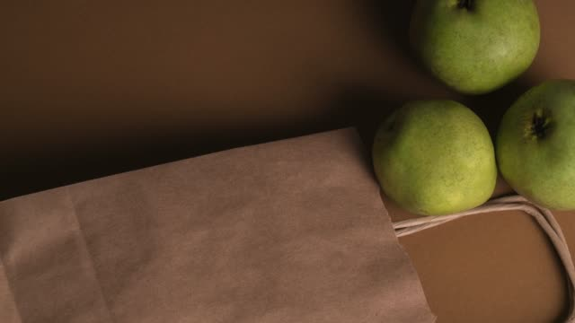 green pear over brown background - brown background stock videos and b-roll footage
