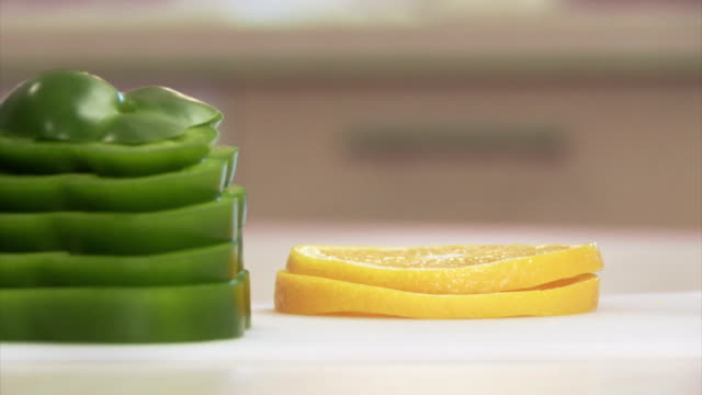 green pepper and orange - next to stock videos & royalty-free footage