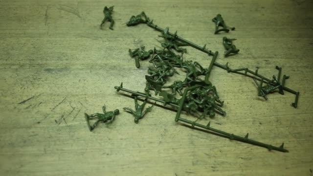 green plastic army men are manufactured by jk manufacturing co in kalkaska michigan us on wednesday dec 7 2016 shots cu of green army man standing... - made in the usa kort fras bildbanksvideor och videomaterial från bakom kulisserna