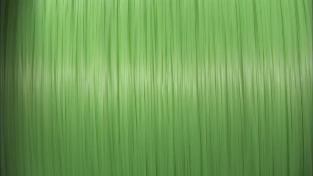 Green, plastic line spins around a spool.