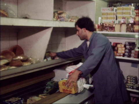 supermarket int ts dairy produce zoom bacon packets gv cheese in cabinet ms assistant zoom bread put onto shelf ts meat in cabinet ts rump steak... - bacon stock videos & royalty-free footage