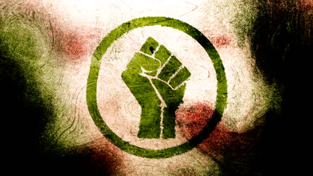 Green, raised fist symbol on a high contrasted grungy and dirty, animated, distressed and smudged 4k video background with swirls and frame by frame motion feel with street style for the concepts of solidarity,support,human rights,worker rights,strength