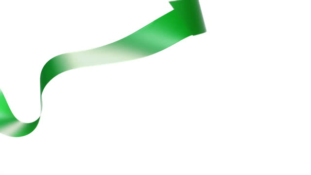a green ribbon on white background, for celebration events and party for new year, birthday party, christmas or any holidays, waiving and curling in super slow motion and close up - banner sign stock videos & royalty-free footage