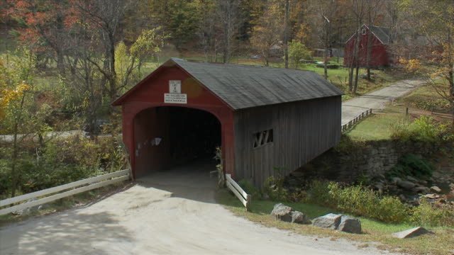 green river covered bridge with bikers - river green stock videos & royalty-free footage