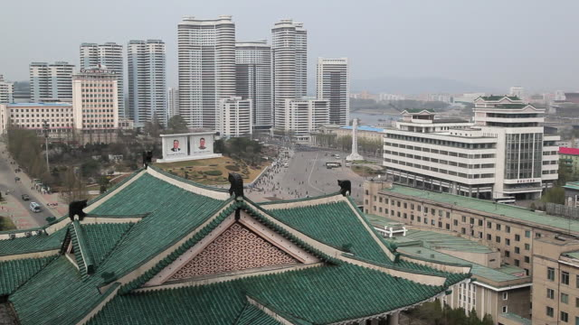 a green roof covers the grand people's study house near downtown pyongyang, north korea. - pyongyang stock videos and b-roll footage