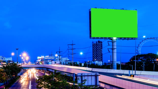 green screen advertising billborad on the road at twilight night