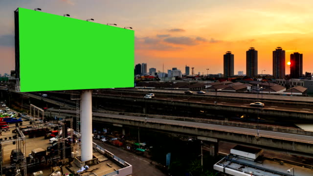 green screen advertising billborad on the road at twilight night - tabellone video stock e b–roll