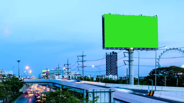 green screen advertising billborad on the road at twilight night - billboard stock videos & royalty-free footage