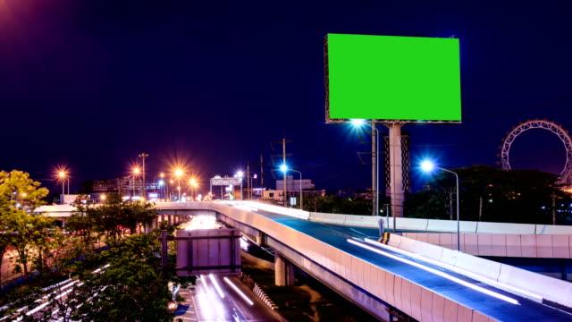 green screen advertising billborad on the road at twilight night