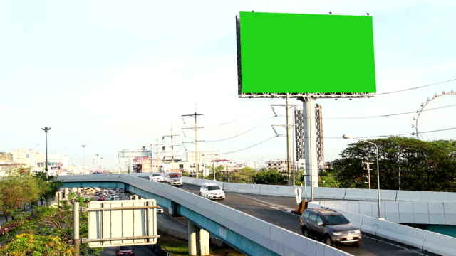 green screen advertising billborad on the road - tabellone video stock e b–roll