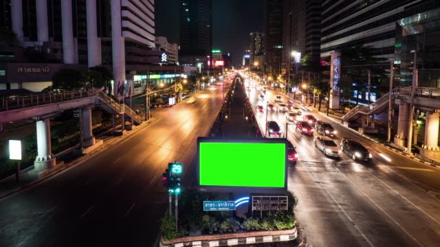 4k : green screen billboard at night - billboard stock videos & royalty-free footage