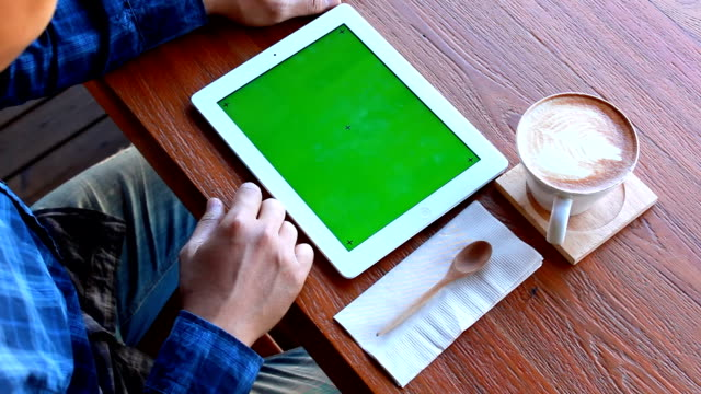 green screen digital tablet with breakfast - over the shoulder stock videos and b-roll footage