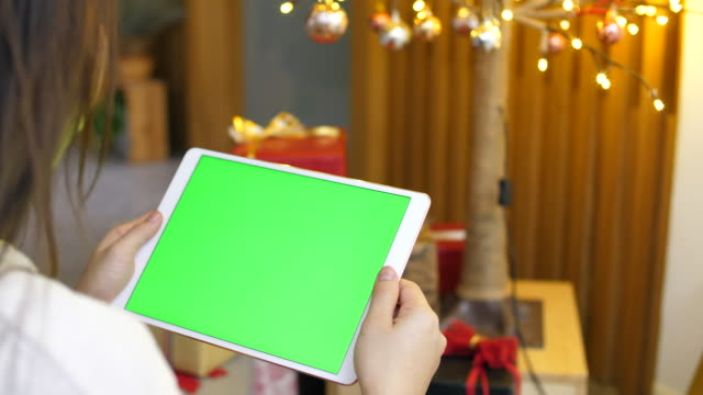 Green screen digital tablet with christmas decoration