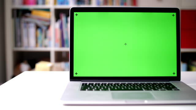 dolly shot: green screen on laptop - table top shot stock videos & royalty-free footage