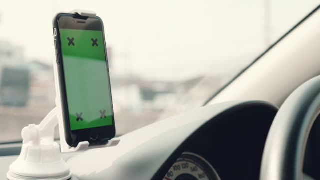 Green screen, people traveling road trip with GPS technology in car