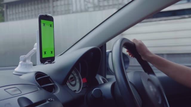 green screen phone in the car - steering wheel stock videos & royalty-free footage
