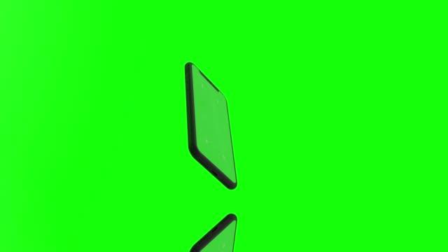 vídeos y material grabado en eventos de stock de 4k pantalla verde girando moderno teléfono inteligente móvil maqueta con puntos de seguimiento y reflejos - plantilla producto de arte y artesanía