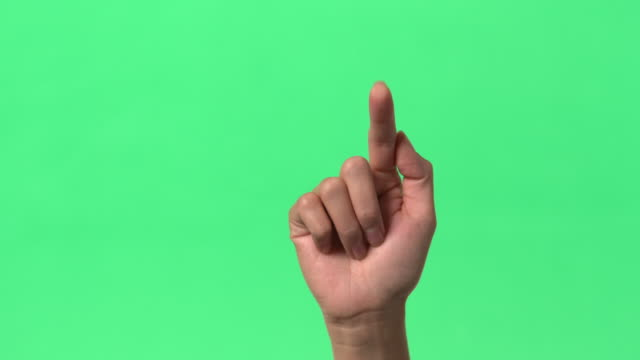 green screen - woman's hand - action of pressing/tapping/typing on glass ramdomly - tapping点の映像素材/bロール