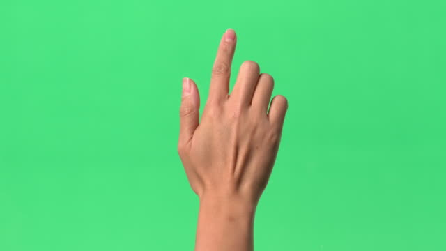 vidéos et rushes de green screen - woman's right hand tapping clear glass with index finder - fond vert