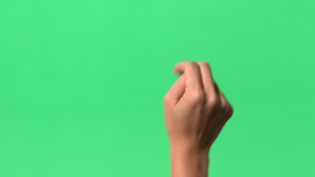 Green Screen - Women's right hand on clear glass. Action of dragging object