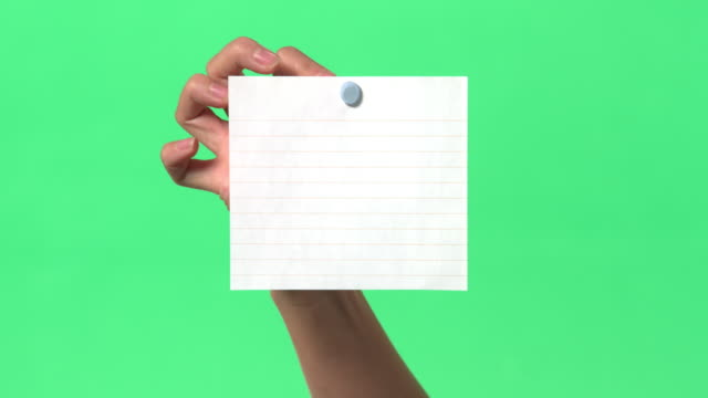 green screen - women's right hand places paper on/off clear glass - adhesive note stock videos & royalty-free footage