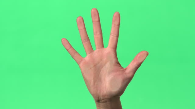 Green Screen - Women's right hand pressed onto glass.