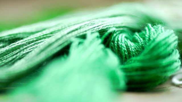 Green silk thread.